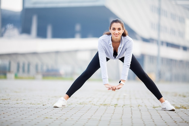 Fitness. woman doing workout exercise on street