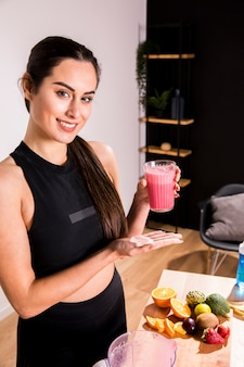 Fitness woman drinking a detox juice