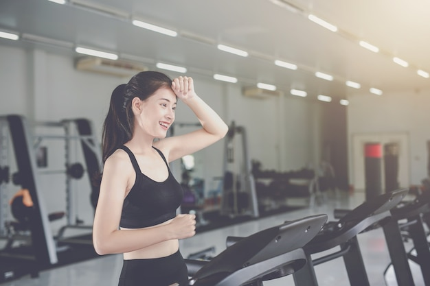 Fitness woman health exercise at gym. healthy workout concepts.