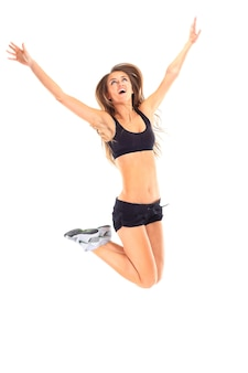 피트 니스 여자 점프 흥분에 고립 된 흰색 배경. 점프 flexing에서 아름 다운 multiracial 아시아 백인 여성 모델의 전신 이미지.
