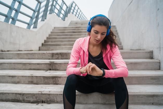 Fitness woman monitoring her progress on smartwatch.