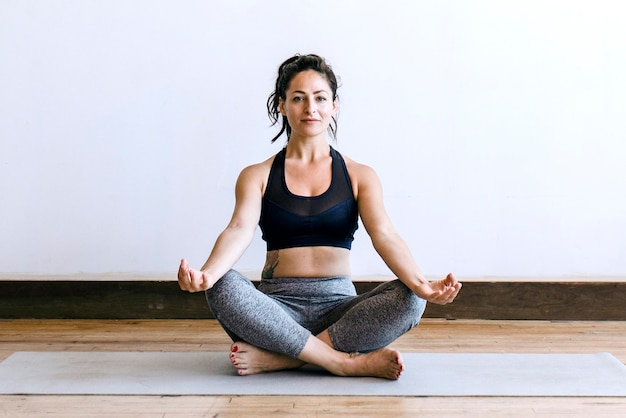 Fitness woman in a padmasana pose