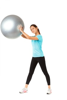 Fitness woman and pilates ball
