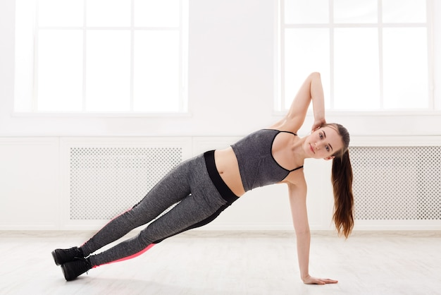 Fitness woman plank training indoors