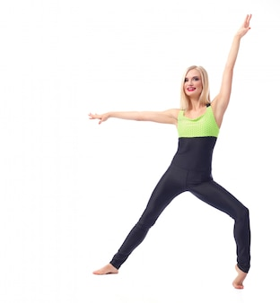 Fitness woman posing gracefully on white