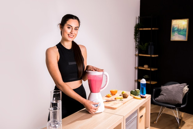 Fitness woman preparing a detox juice