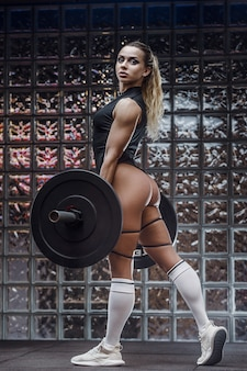 피트 니스 여자 엉덩이 엉덩이 전리품 다리 근육을 펌핑