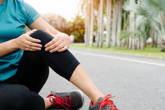 Fitness woman runner feel pain on knee