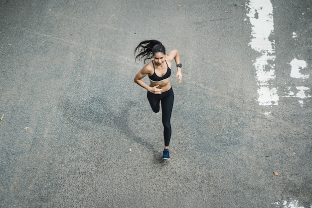 Fitness woman running the road