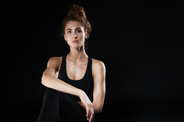 Fitness woman sitting in studio