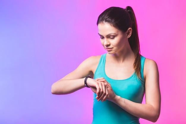 Fitness woman using fitness tracker on wrist