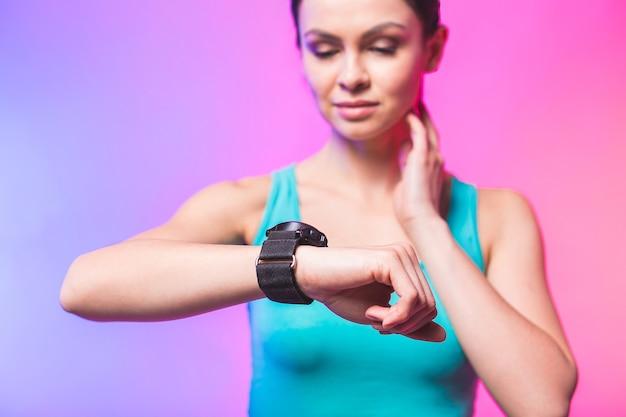 Fitness woman using fitness tracker