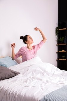 Fitness woman waking up in the morning