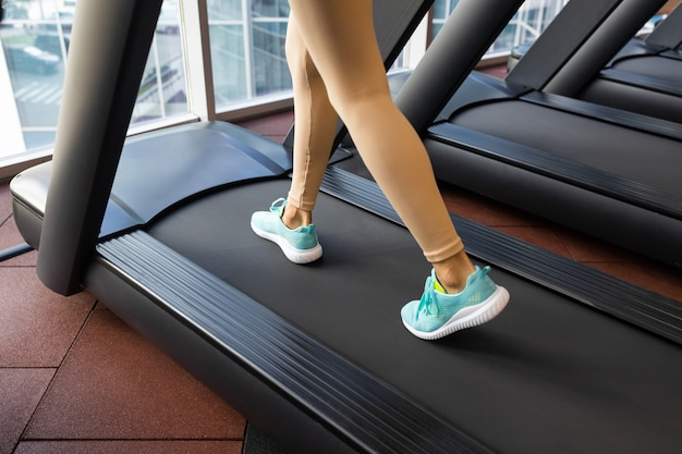 Fitness woman walking and running in the treadmill