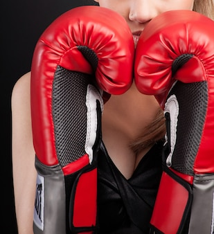 Fitness woman with red boxing gloves