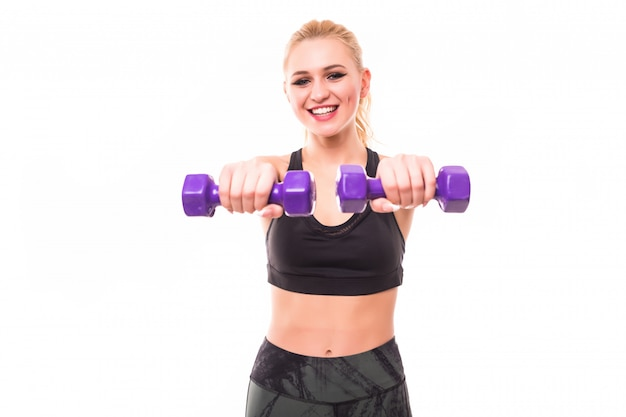 Fitness woman working out with blue dumbbells