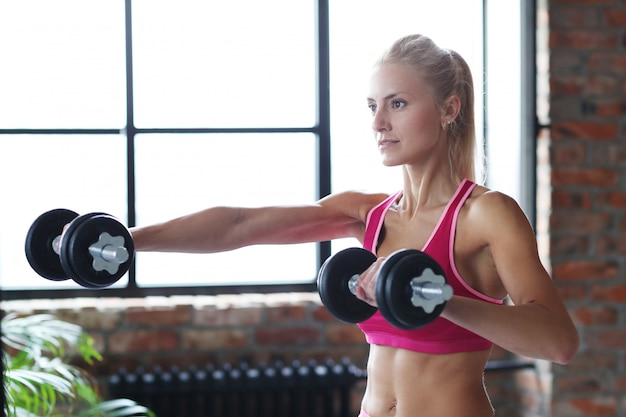 Fitness woman workout with dumbbells