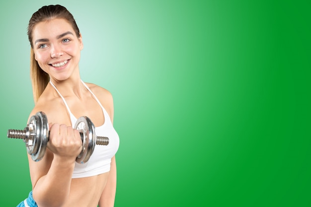 Fitness woman. young sporty caucasian female model isolated