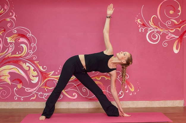 Fitness or yoga class, woman doing exercise