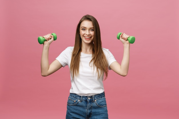 Fitness, young woman with dumbbell