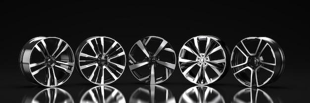 Пять дисков автомобиля на черном фоне. 3d рендеринг иллюстрации.