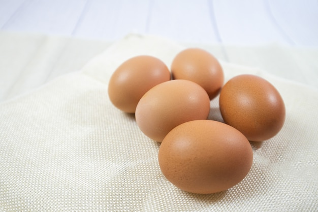 Five chicken egg on sack