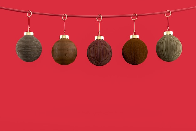 Five christmas balls hanging with red background . merry christmas concept