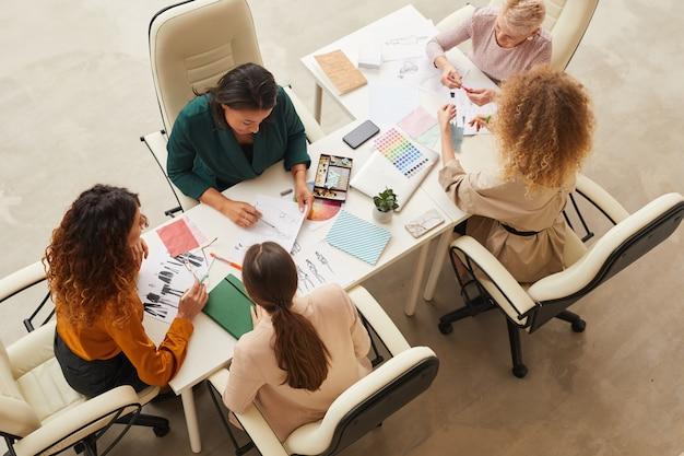 Five designers coworking top shot