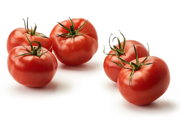 Five fresh juicy pink tomatoes on a white background. isolated.