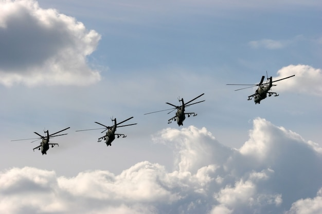 Five military helicopters flying during air show