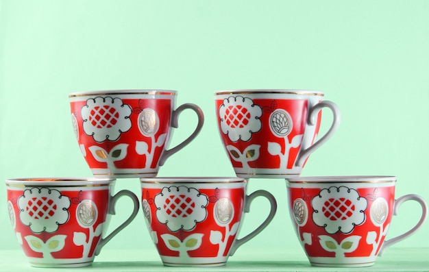 Five retro cups on a blue