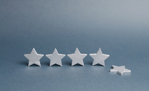Five silver stars, one star fell