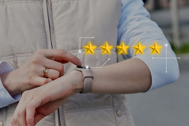 Five star rating concept. the person uses a smart watch.