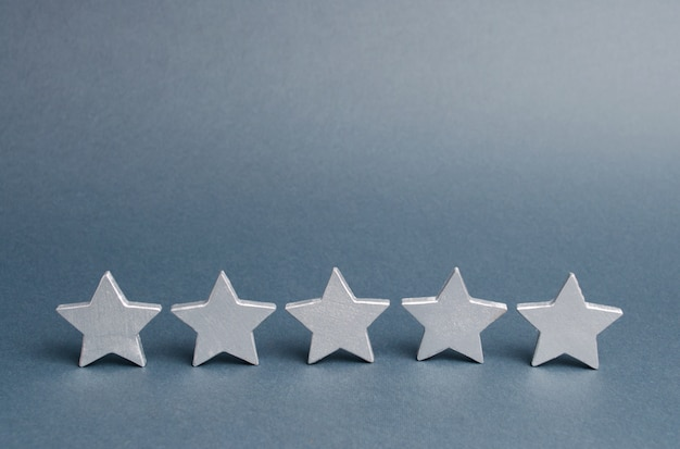 Five stars on a gray. success in business. the concept of rating and evaluation