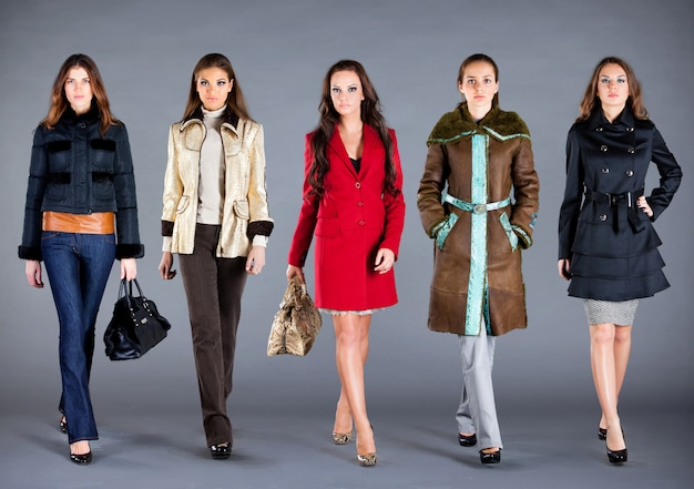 Five women in different clothes, autumn winter collection clothes