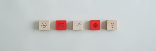 Five wooden blocks with contact and information icons
