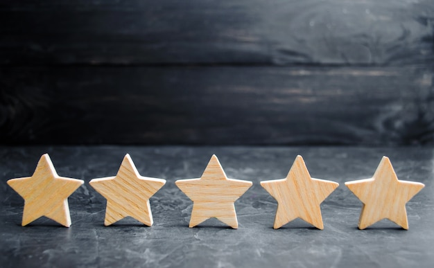 Five wooden stars. get the fifth star.
