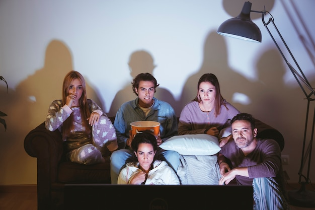 Five young friends watching a movie