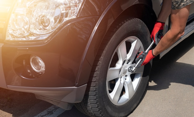 Fixing inspection and checking wheel tyre of car with manual tool