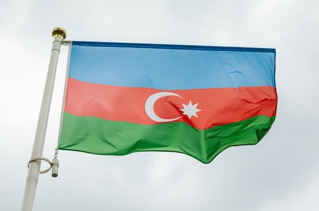 Flag of azerbaidjan waving in the wind ablazed