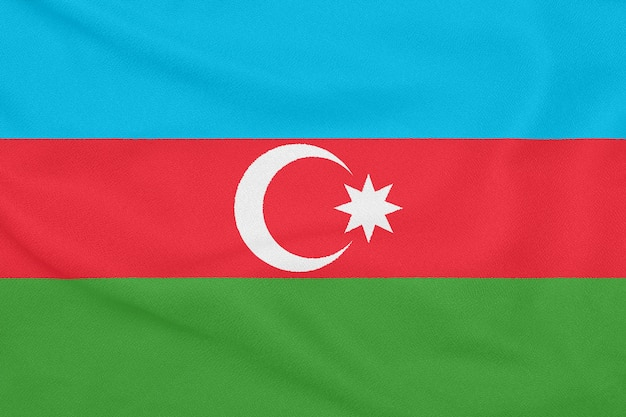 Flag of azerbaijan on textured fabric. patriotic symbol