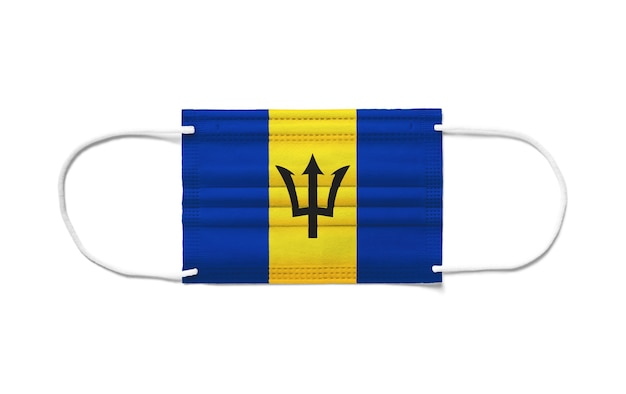 Flag of barbados on a disposable surgical mask. white surface  isolated
