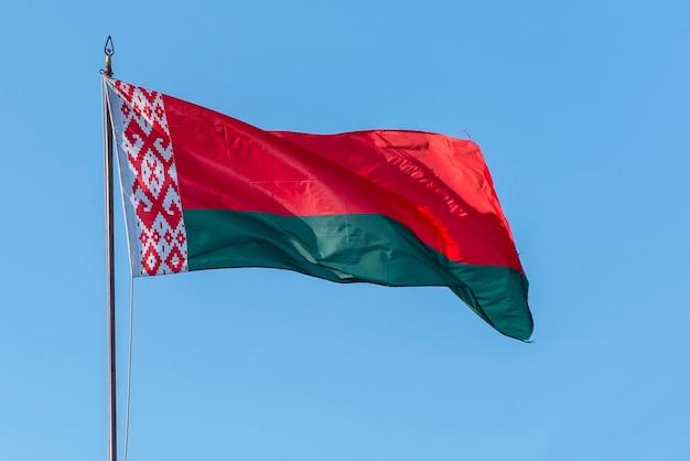 Flag of belarus waving against blue sky