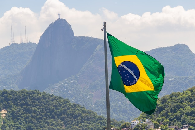 Flag of brazil with image of christ the redeemer