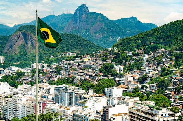 Flag of brazil with rio de janeiro in the background