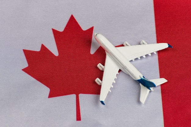 Flag of canada and model airplane. flights to canada after quarantine. resumption of flights