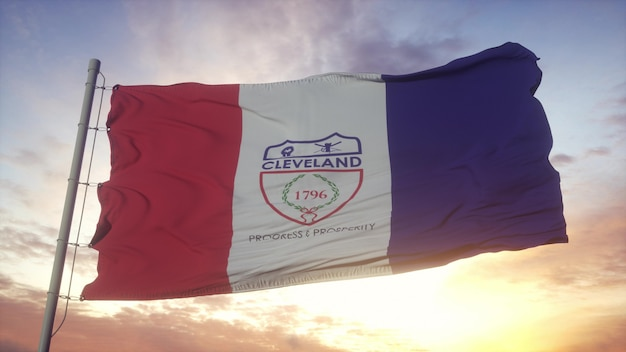 Flag of cleveland, city of ohio waving in the wind, sky and sun background. 3d rendering