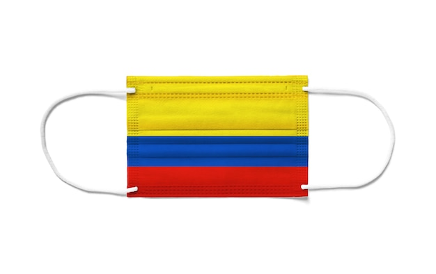 Flag of colombia on a disposable surgical mask. white background isolated