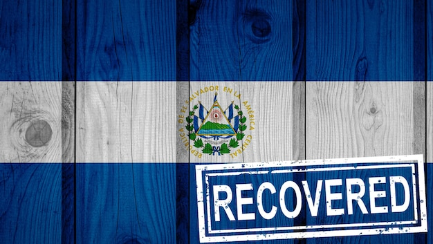Flag of el salvador that survived or recovered from the infections of corona virus epidemic or coronavirus. grunge flag with stamp recovered