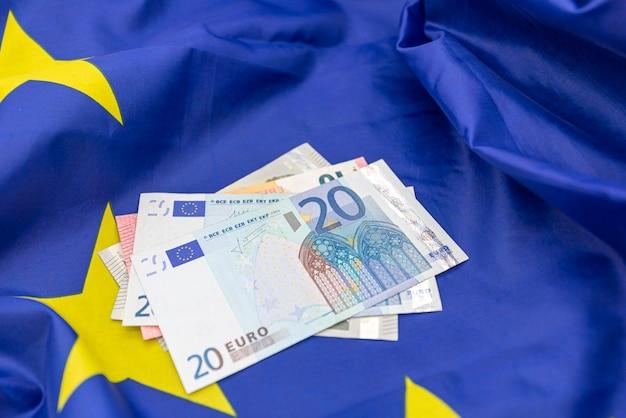 Flag of european union eu and some money euros on the top
